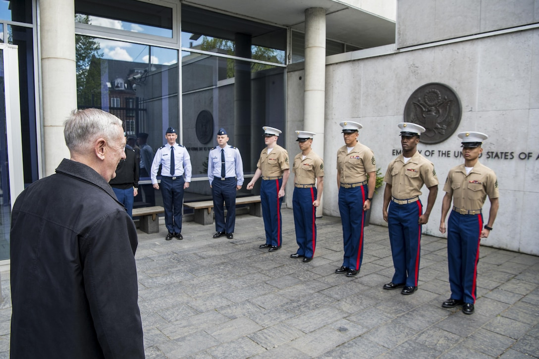 Defense Secretary Jim Mattis greets service members