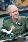 "Former airline pilot Chesley ""Sully"" Sullenberger III listens to a briefing before his flight with the United States Air Force Thunderbirds at Travis Air Force Base, Calif., May 4, 2017. Sullenberger is a 1973 Air Force Academy graduate and is best known for successfully landing a crippled airliner in the Hudson River saving the lives of 155 passengers. (U.S. Air Force photo by Louis Briscese)"