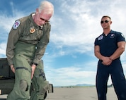 "Former airline pilot, Chesley ""Sully"" Sullenberger III, puts on his G-suit before his flight with the United States Air Force Thunderbirds at Travis Air Force Base, Calif., May 4, 2017. Sullenberger is a 1973 Air Force Academy graduate and is best known for successfully landing a crippled airliner in the Hudson River saving the lives of 155 passengers. (U.S. Air Force photo by Louis Briscese)"