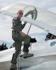 "Former airline pilot, Chesley ""Sully"" Sullenberger III, poses for a photo before his flight with the United States Air Force Thunderbirds at Travis Air Force Base, Calif., May 4, 2017. Sullenberger is a 1973 Air Force Academy graduate and is best known for successfully landing a crippled airliner in the Hudson River saving the lives of 155 passengers. (U.S. Air Force photo by Louis Briscese)"