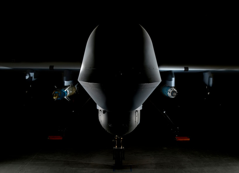 An MQ-9 Reaper is loaded with a GBU-12 laser-guided bomb on the left and a GBU-38 Joint Direct Attack Munition on the right April 13, 2017, at Creech Air Force Base, Nev. The JDAM is a GPS guided munition which brings added capability to the warfighters, specifically by aircrews being able to employ weapons through inclement weather. The first two GBU-38s employed in training successfully hit their targets May 1, 2017, over the Nevada Test and Training Range. (U.S. Air Force photo by Senior Airman Christian Clausen)