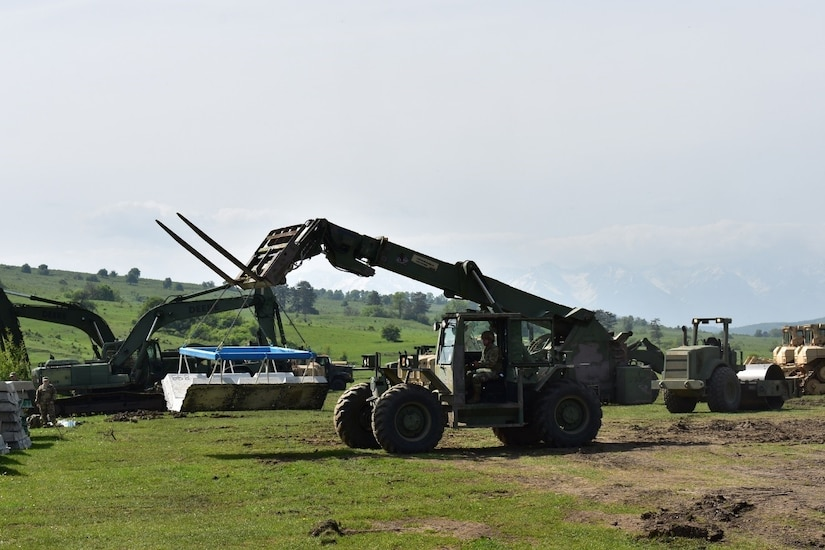 Army Reserve Spc. George Flowers, with the 381st Engineer Company, forklifts an articulated concrete mat as part of Resolute Castle 17 at Joint National Training Center, Cincu, Romania, May 4, 2017. The concrete mat is used as a foundation for roads in wet areas and low-water crossings. Army photo by Capt. Colin Cutler