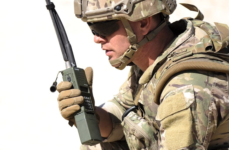 Staff Sgt. Christopher Eccard, 99th Civil Engineer Squadron explosive ordnance dispersal technician, uses a radio to communicate with other EOD teams during a training exercise on Nellis Air Force Base, Nev., May 3, 2017. EOD technicians are trained to detect, disarm, detonate and dispose explosive threats worldwide. (U.S. Air Force photo by Senior Airman Kevin Tanenbaum/Released)