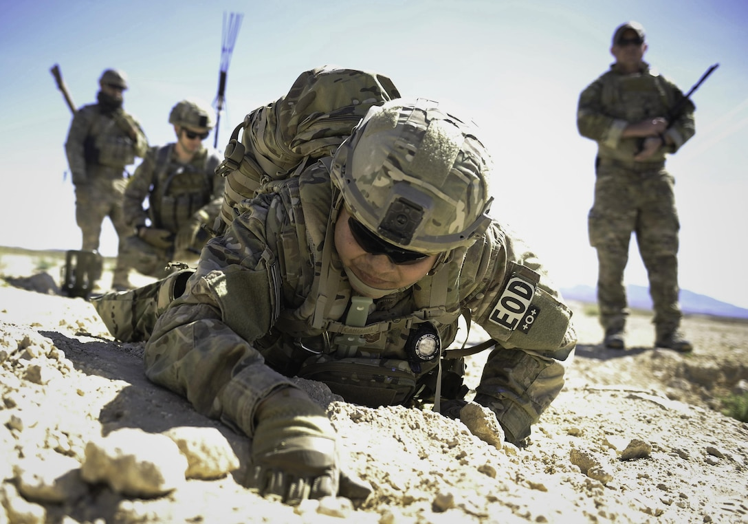 Tech. Sgt. Kenneth Westrum, 99th Civil Engineer Squadron explosive ordnance disposal technician, and his team search for a wire during a training operation on Nellis Air Force Base, Nev., May 3, 2017. EOD technicians are assigned to some of the most dangerous missions. They perform tactically harrowing and technically demanding tasks in diverse environments worldwide. (U.S. Air Force photo by Senior Airman Kevin Tanenbaum/Released)