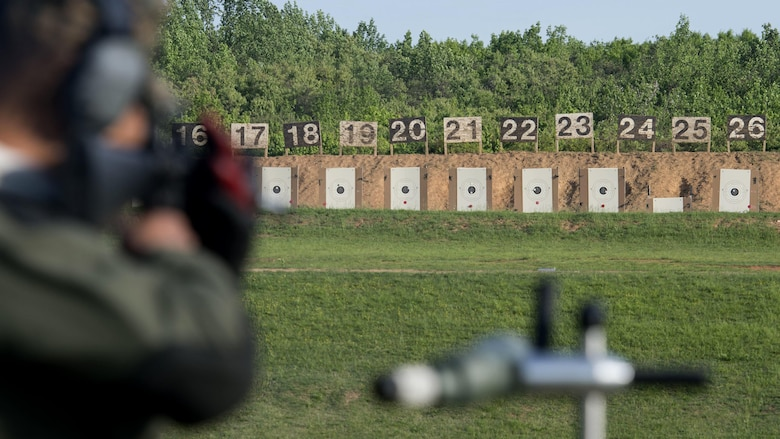A Marine observes his target after firing during the Marine Corps Shooting Team Championships on Marine Corps Base Quantico, Va. May 4, 2017. Each year, the Marine Corps Shooting Team hosts the championship matches for medalists from each regional Marine Corps Markmanship Competition site to compete in individual and team matches.