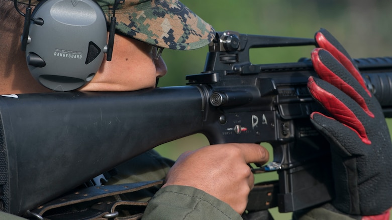 A Marine aims down his sights during the Marine Corps Shooting Team Championships on Marine Corps Base Quantico, Va. May 4, 2017. Each year, the Marine Corps Shooting Team hosts the championship matches for medalists from each Marine Corps Markmanship Competition site to compete in individual and team matches.