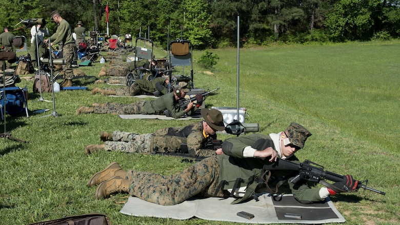Marines prepare to fire in the prone position during the Marine Corps Shooting Team Championships on Marine Corps Base Quantico, Va. May 3, 2017. Each year, the Marine Corps Shooting Team hosts the championship matches for medalists from each regional Marine Corps Markmanship Competition site to compete in individual and team matches.