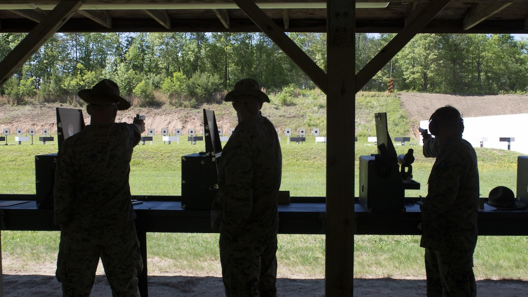 Marines fire down the pistol range during the Marine Corps Shooting Team Championships on Marine Corps Base Quantico, Va. May 3, 2017. Each year, the Marine Corps Shooting Team hosts the championship matches for medalists from each regional Marine Corps Markmanship Competition site to compete in individual and team matches.