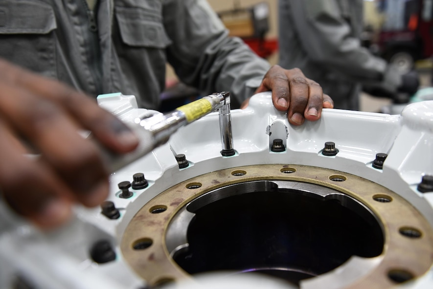 Senior Airman Jason Clark, 19th Aircraft Maintenance Squadron Hydraulics Centralized Repair Facility journeyman, secures 14 brake housing bolts during assembly of a C-130J carbon brake May 2, 2017, at Little Rock Air Force Base, Ark. As the only CRF in AMC, the 19th AMXS Hydraulics Shop is the sole provider of C-130J hydraulic repairs, saving the U.S. Air Force millions of dollars annually. (U.S. Air Force photo by Airman 1st Class Kevin Sommer Giron)