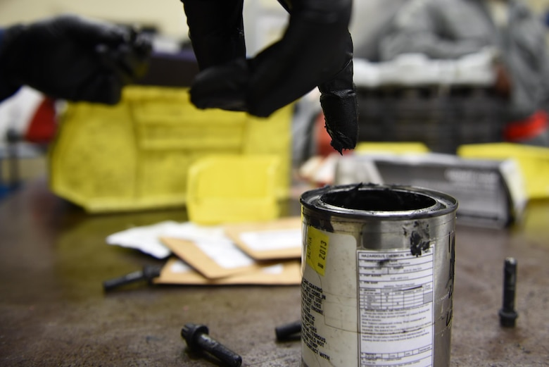 Senior Airman Osaro Obayuwana, 19th Aircraft Maintenance Squadron Hydraulics Centralized Repair Facility journeyman, applies an anti-seize lubricant to a brake housing bolt before installation May 2, 2017, at Little Rock Air Force Base, Ark. The substance prevents the bolts from clutching the brake housing due to extreme heat produced during operations. (U.S. Air Force photo by Airman 1st Class Kevin Sommer Giron)