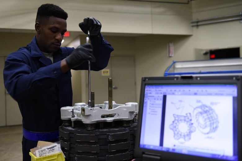 Senior Airman Osaro Obayuwana, 19th Aircraft Maintenance Squadron Hydraulics Centralized Repair Facility journeyman, assembles a C-130J carbon brake May 2, 2017, at Little Rock Air Force Base, Ark. The 19th AMXS CRF Airmen are responsible for repairing all fluid, air and gas-pressured devices on the C-130J fleet. (U.S. Air Force photo by Airman 1st Class Kevin Sommer Giron)