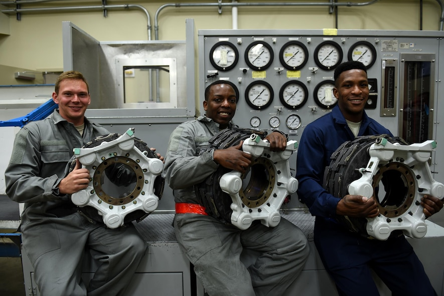 (From left) Senior Airmen Kevin Heater, Jason Clark and Osaro Obayuwana, 19th Aircraft Maintenance Squadron Hydraulics Centralized Repair Facility journeymen, repair three C-130J carbon brakes May 2, 2017, at Little Rock Air Force Base, Ark. A hydraulic test stand is used to check the brake's functionality once the overhaul is complete. (U.S. Air Force photo by Airman 1st Class Kevin Sommer Giron)