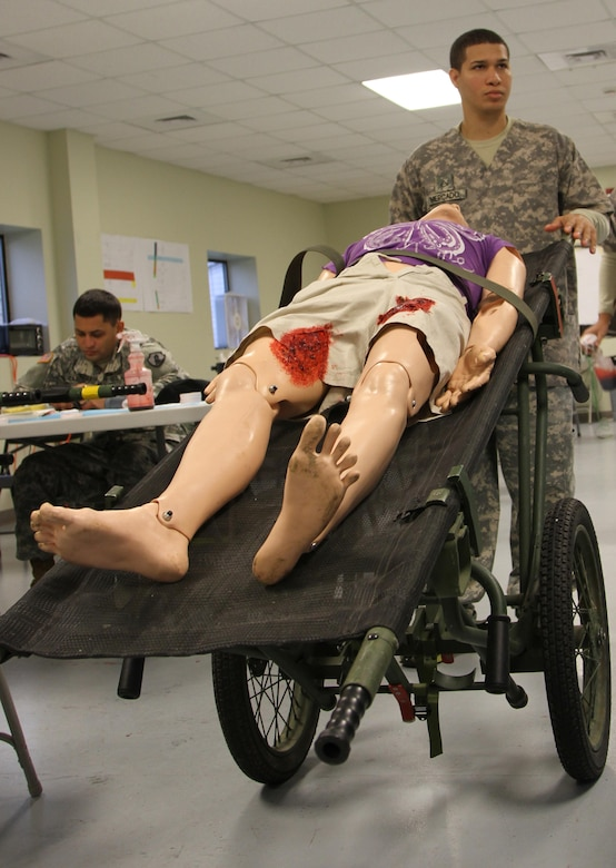 MUSCATATUCK URBAN TRAINING CENTER, Indiana (May 5, 2017) – Pfc. Angel Mercado from Sabana Grande, Puerto Rico, an ammunition specialist with the U.S. Army Reserve's 266th Ordnance Company, carts off a mannequin dressed as a casualty to be used in the U.S. Army Reserve's Guardian Response 17 at the Muscatatuck Urban Training Center (MUTC), Indiana, May 5, 2017. Nearly 4,100 Soldiers from across the country are participating in Guardian Response 17, a multi-component training exercise to validate U.S. Army units' ability to support the Defense Support of Civil Authorities (DSCA) in the event of a Chemical, Biological, Radiological, and Nuclear (CBRN) catastrophe.