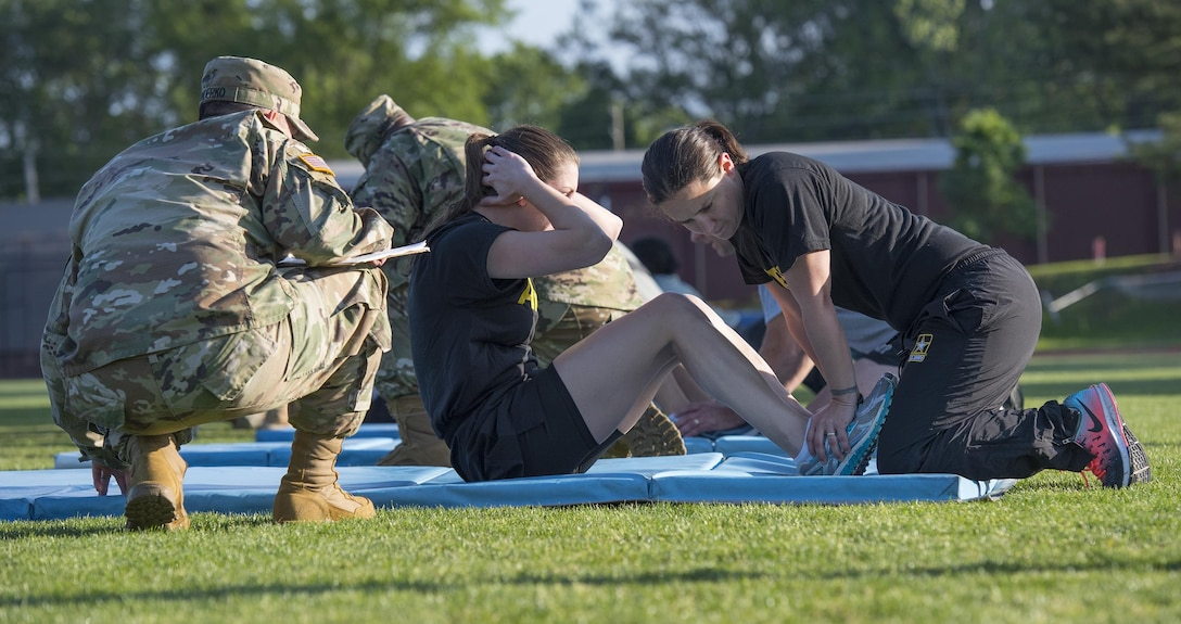 U.S. Army Reserve 1st Lt. Caroline Shaw, of Lower Burrell, Pa., an aide-de-camp for 335th Signal Command (Theater) deputy commanding general of sustainment Brig. Gen. Nikki Griffin-Olive, does sit-ups to pass the Army Physical Fitness Test on a field near the 335th headquarters in East Point, Ga., May 6, 2017. The APFT is designed to test the muscular strength, endurance, and cardiovascular respiratory fitness of soldiers in the Army. Soldiers are scored based on their performance in three events consisting of the push-up, sit-up, and a two-mile run, ranging from 0 to 100 points in each event. (U.S. Army Reserve photo by Staff Sgt. Ken Scar)