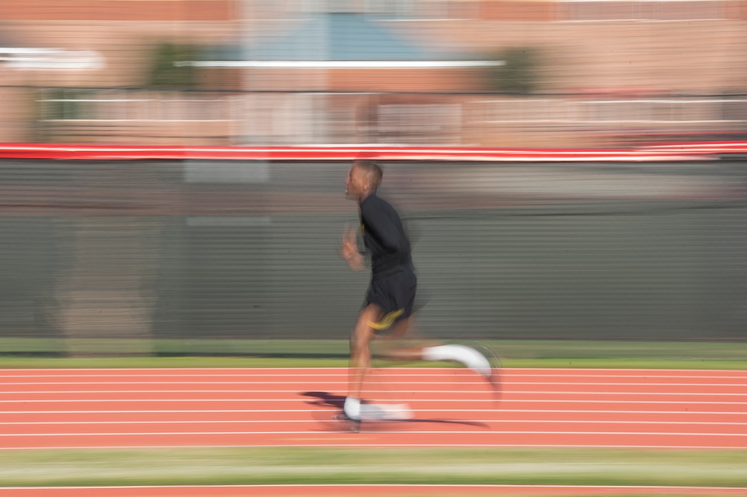 A U.S. Army Reserve Soldier with the 335th Signal Command (Theater) runs two miles to pass the Army Physical Fitness Test in East Point, Ga., May 6, 2017. The APFT is designed to test the muscular strength, endurance, and cardiovascular respiratory fitness of soldiers in the Army. Soldiers are scored based on their performance in three events consisting of the push-up, sit-up, and a two-mile run, ranging from 0 to 100 points in each event. (U.S. Army Reserve photo by Staff Sgt. Ken Scar)
