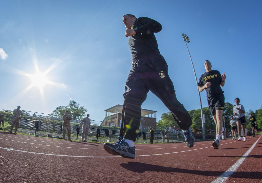 U.S. Army Reserve Sgt. 1st Class Brent Powell, a public affairs noncommissioned officer for the 335th Signal Command (Theater) from Pocahontas, Ark., runs two miles to pass the Army Physical Fitness Test at Woodward Academy in East Point, Ga., May 6, 2017. The APFT is designed to test the muscular strength, endurance, and cardiovascular respiratory fitness of soldiers in the Army. Soldiers are scored based on their performance in three events consisting of the push-up, sit-up, and a two-mile run, ranging from 0 to 100 points in each event. (U.S. Army Reserve photo by Staff Sgt. Ken Scar)