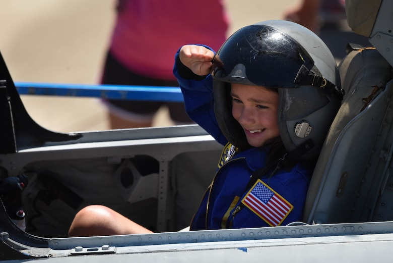 A child salutes in the cockpit of a static display during the 2017 Defenders of Liberty Air Show at Barksdale Air Force Base, La., May 7. Held for the first time in 1933, the Barksdale Air Force Base air show is a full weekend of military and civilian aircraft and performances and displays. (U.S. Air Force photo/Airman 1st Class Stuart Bright)