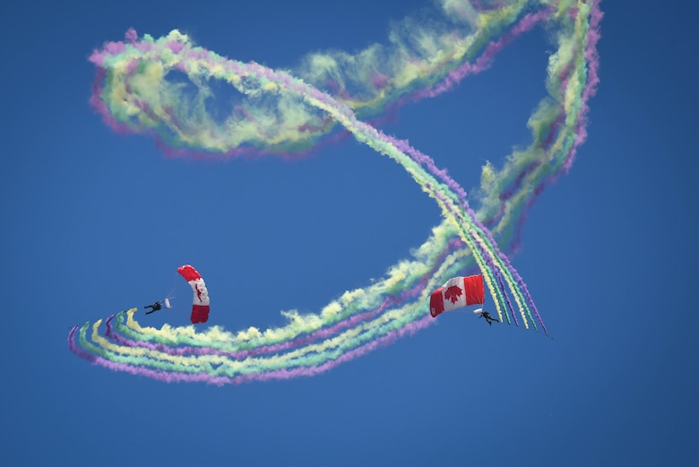 Members of the Canadian Skyhawks team descend from the sky with an assortmant of colors at Barksdale Air Force Base, La., May 7, 2017. The team takes great pride in showcasing the professionalism, dedication and teamwork it takes to be part of Canada's military. (U.S. Air Force photo/Airman 1st Class Stuart Bright)