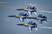 The U.S. Navy Flight Demonstration Team Blue Angels F/A-18 Hornets perform an aerial maneuver for the Defenders of Liberty Air Show at Barksdale Air Force Base, La., May 7, 2017. The mission of the Blue Angels is to showcase the pride and professionalism of the United States Navy and Marine Corps by inspiring a culture of excellence and service to country through flight demonstrations and community outreach. (U.S. Air Force photo/Airman 1st Class Stuart Bright)