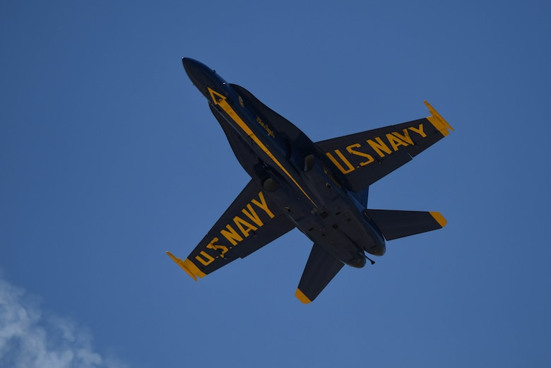 The U.S. Navy Flight Demonstration Team Blue Angels F/A-18 Hornets perform an aerial maneuver for the Defenders of Liberty Air Show at Barksdale Air Force Base, La., May 7, 2017. The highly competitive selection process for joining the Blue Angels' team guarantees the squadron's tradition of excellence, ensuring the Blue Angels are a direct reflection of the professionalism of today's sailors and Marines. (U.S. Air Force photo/Airman 1st Class Stuart Bright)