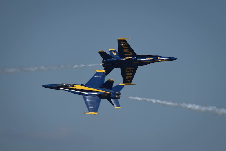 The U.S. Navy Flight Demonstration Team Blue Angels F/A-18 Hornets perform an aerial maneuver for spectators during the Defenders of Liberty Air Show at Barksdale Air Force Base, La., May 7, 2017. The Blue Angels first air show was at Craig Field, Jacksonville, Florida, June 15, 1946. (U.S. Air Force photo/Airman 1st Class Stuart Bright)
