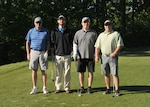 The winning team, from left: Dave Peterson, direct delivery fuels director, DLA Energy; Bruce Blank, supervisory procurement analyst, DLA Energy; Cliff Sands, supervisory general engineer, DLA Installation Support; Justin Wingo, contract specialist, DLA Energy