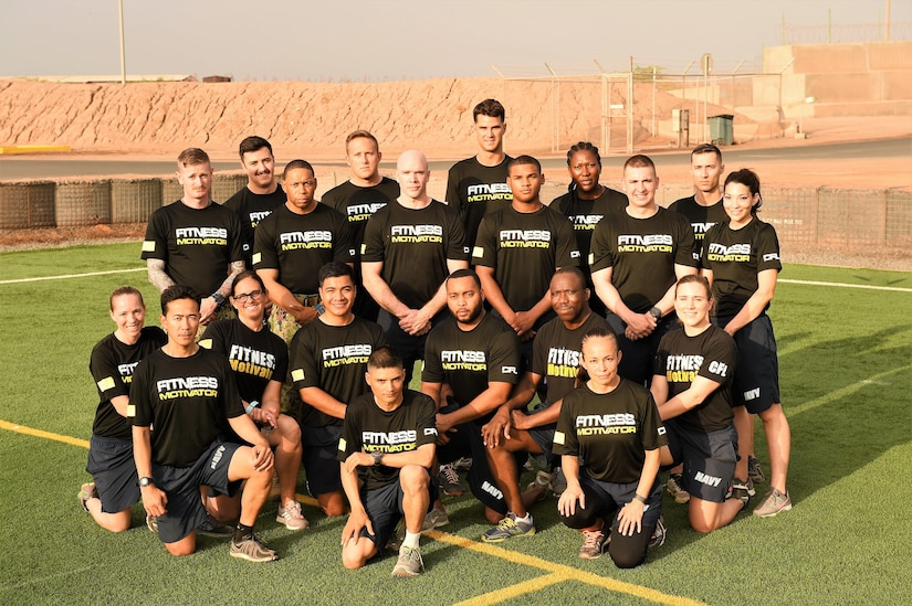 Members of Camp Lemmonier and Combined Joint Task Force Horn of Africa fitness leaders show off their new assistant command fitness leader physical training shirts at Camp Lemonnier, Djibouti, April 28, 2017. Navy fitness leaders commonly wear distinctive shirts to signify their role in assisting with their shipmates' fitness success. Air Force photo by Tech. Sgt. Andria Allmond