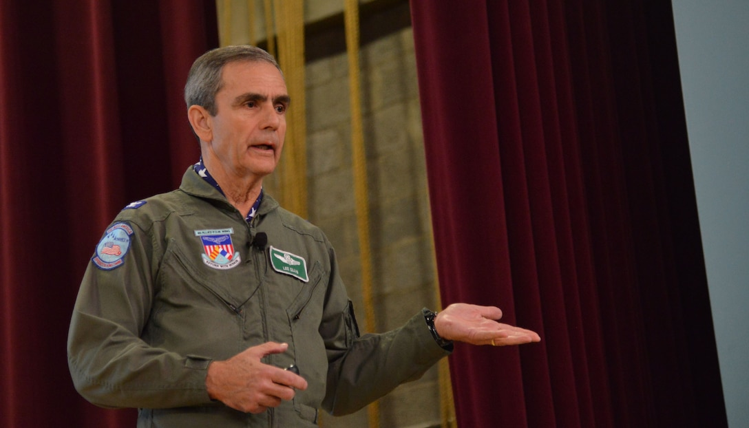 Retired colonel and former Vietnam prisoner of war Lee Ellis speaks to Team Kirtland members May 2-3 at the Base Theater. Ellis spoke about the importance of character, courage, commitment in leaders.