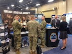 Defense Logistics Agency Aviation, Army Customer Facing Division soldiers and civilian employees answer customers' supportability questions April 27, 2017 at DLA's exhibit during the 2017 Army Aviation Mission Solutions Summit at the Gaylord Opryland Resort and Convention Center in Nashville, Tennessee.