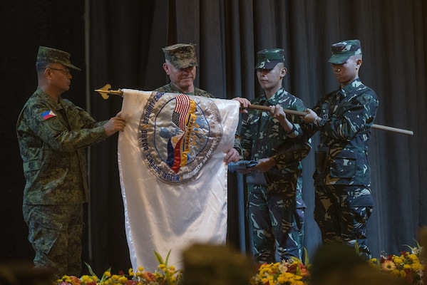 Armed Forces of the Philippines Lt. Gen. Oscar T. Lactao, left, and U.S. Marine Lt. Gen. Lawrence D. Nicholson unfurl the Balikatan 2017 flag during the opening ceremony at Camp Aguinaldo, Quezon City, May 8, 2017. Lactao is the Philippine exercise director for Balikatan and Nicholson is the commanding general of III Marine Expeditionary Force. Balikatan is an annual U.S.-Philippine bilateral military exercise focused on a variety of missions including humanitarian and disaster relief, counterterrorism, and other combined military operations.