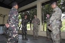 Philippine and U.S. service members meet and discuss bilateral training plans for Balikatan 2017 at Ft. Magsaysay in Santa Rosa, Nueva Ecija, May 5, 2017. Balikatan is an annual U.S.-Philippine bilateral military exercise focused on a variety of missions including humanitarian and disaster relief, counterterrorism, and other combined military operations.