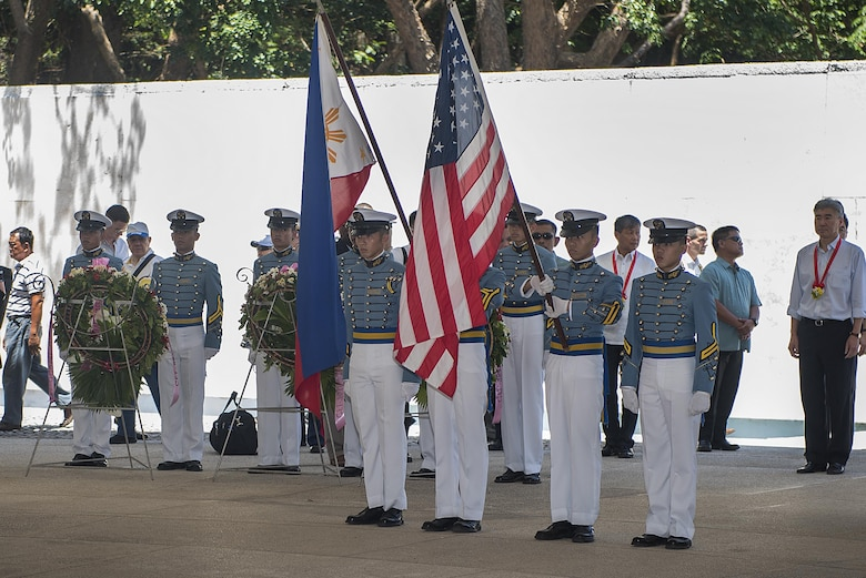 Maritime Academy of Asia and the Pacific cadets display the Philippine and U.S. flags at a ceremony to mark the 75th anniversary of the fall of Corregidor to the Japanese during World War II on Corregidor, Cavite, May 6, 2017. The ceremony was held to commemorate the Marines, Soldiers, Sailors and Filipinos who fought and sacrificed to defend the Philippines during World War II.