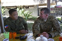 Philippine Army Col. Lawrence Mina and U.S. Army Lt. Col. Andrew Graham discuss bilateral training plans during Balikatan 2017 at Calayan Island, Philippines, May 6, 2017. Mina is deputy Assistance Chief of Staff for Training and Education Staff, Philippine Army and Graham is the commander with 3rd Battalion, 25th Aviation Regiment, 25th Combat Aviation Brigade. Balikatan is an annual U.S.-Philippine bilateral military exercise focused on a variety of missions including humanitarian and disaster relief, counterterrorism, and other combined military operations.