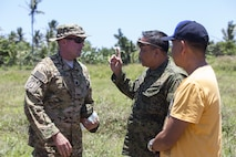 U.S. Army Lt. Col. Andrew Graham, Philippine Army Col. Lawrence Mina and Mayor Alfonso Llopis discuss bilateral training plans during Balikatan 2017 on Calayan Island, Philippines, May 6, 2017. Graham is the commander with 3rd Battalion, 25th Aviation Regiment, 25th Combat Aviation Brigade. Mina is deputy Assistance Chief of Staff for Training and Education Staff, Philippine Army. Llopis is the mayor of Calayan. Balikatan is an annual U.S.-Philippine bilateral military exercise focused on a variety of missions including humanitarian and disaster relief, counterterrorism, and other combined military operations.
