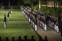 """The marching companies of Marine Barracks Washington D.C., perform """"fix-bayonets"""" during a Friday Evening Parade at Marine Barracks Washington D.C., May 5, 2017. The guests of honor for the parade were the Honorable Paul Cook, California's 8th Congressional District Congressman, the Honorable Jack Bergman, Michigan's 1st Congressional District Congressman, and the Honorable Salud Carbajal, California's 24th Congressional District Congressman. The hosting official was Gen. Glenn Walters, assistant commandant of the Marine Corps. (Official Marine Corps photo by Cpl. Robert Knapp/Released)"""