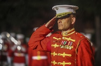 Major Christopher Hall, commanding officer, U.S. Marine Drum & Bugle Corps, salutes the parade commander during a Friday Evening Parade at Marine Barracks Washington D.C., May 5, 2017. The guests of honor for the parade were the Honorable Paul Cook, California's 8th Congressional District Congressman, the Honorable Jack Bergman, Michigan's 1st Congressional District Congressman, and the Honorable Salud Carbajal, California's 24th Congressional District Congressman. The hosting official was Gen. Glenn Walters, assistant commandant of the Marine Corps.