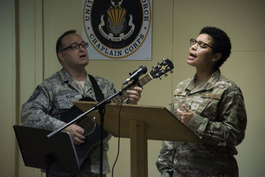 "Senior Master Sgt. Robert Clark, a 386th Expeditionary Aircraft Maintenance Squadron first sergeant, and Staff Sgt. Mikele Long, a 386th Expeditionary Security Forces Squadron member, perform their rendition of ""Undescribable"" during a Faith Works leadership luncheon, at an undisclosed location in Southwest Asia, May 4, 2017. The U.S. Air Force Chaplain Corps recently rolled out the Faith Works campaign to inform Airmen about the overwhelming evidence regarding the positive relationship between spirituality, religion, and health. (U.S. Air Force photo/ Tech. Sgt. Jonathan Hehnly)"