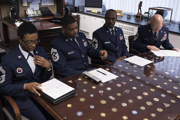Chief Master Sergeant Phillip L. Easton, U.S. Air Forces in Europe and Air Forces Africa command chief master sergeant, (second from left) provides the rules of engagement to board members as he presides over the USAFE-AFAFRICA 12 Outstanding Airmen of the Year board, March 9, 2017, Ramtein Air Base, Germany. (U.S. Air Force Photo/Tech. Sgt. Micky M. Pena)