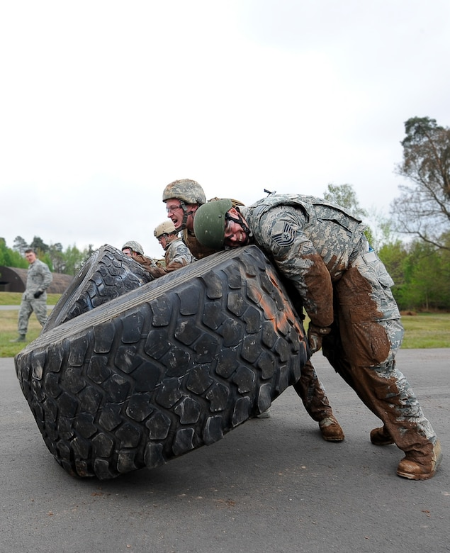 Members from the 435th Contingency Response Group flip tires in an obstacle course during the 435th CRG Olympics on Ramstein Air Base, Germany, May 5, 2017. An obstacle course, Kaiser Sled, and a pallet build were among six events held during the 435th CRG Olympics. (U.S. Air Force photo by Airman 1st Class Savannah L. Waters)