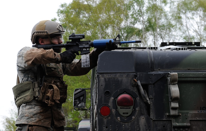 Staff Sgt. Jose Ruiz, 435th Security Forces Squadron Ground Combat Readiness Training Center instructor, fires an M4 over a Humvee during the 435th Contingency Response Group Olympics on Ramstein Air Base, Germany, May 5, 2017. The 435th CRG Olympics was an event that helped to build morale, good comradery, and provide training for Airmen across the group. (U.S. Air Force photo by Airman 1st Class Savannah L. Waters)