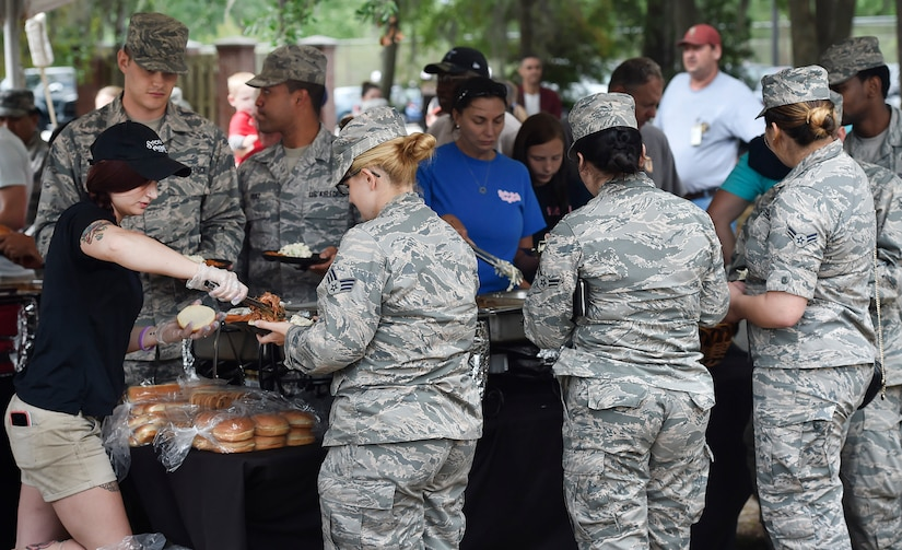 Servicemembers, civilians and their families attend a base picnic at Joint Base Charleston, S.C., May 5, 2017.  Attendees were provided free meals were and able to participate in various activities including face painting, wall rock climbing, live music and a Military Working Dog demonstration.