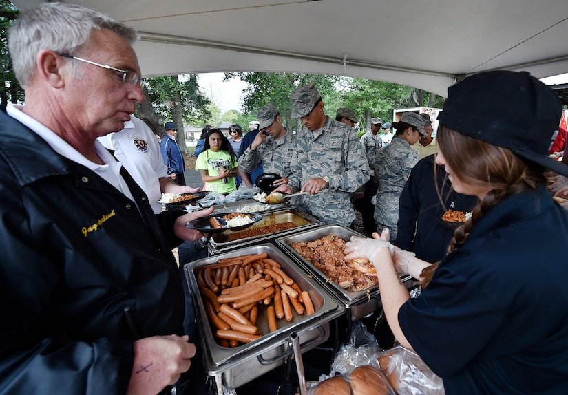 Servicemembers, civilians and their families attend a base picnic at Joint Base Charleston, S.C., May 5, 2017.  Attendees were provided free meals and were able to participate in various activities including face painting, wall rock climbing, live music and a Military Working Dog demonstration.