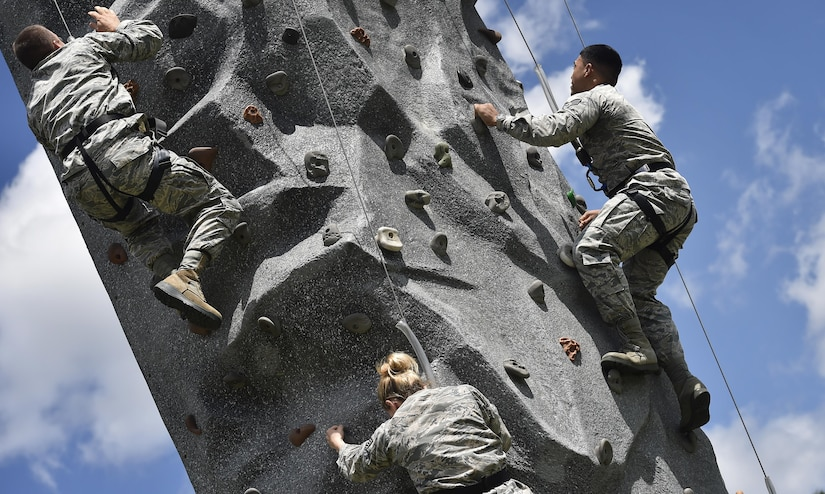 Airmen of the 628th Logistics Readiness Squadron, race up a rock wall during a base picnic at the Air Base Picnic Grounds May 5, 2017, at Joint Base Charleston, S.C. Attendees were provided free meals and were able to participate in various activities including face painting, wall rock climbing, live music and a Military Working Dog demonstration.