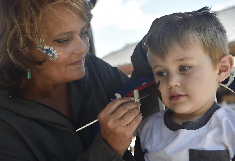 Jacobi, 3 years old  and son of U.S. Air Force Airman 1st Class Collin Dobbel, 628th Civil Engineer Squadron operations management apprentice, gets his face painted during a base picnic at the Air Base Picnic Grounds May 5, 2017, at Joint Base Charleston, S.C. Attendees were provided free meals and were able to participate in various activities including face painting, wall rock climbing, live music and a Military Working Dog demonstration.
