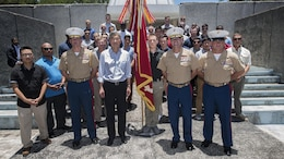 U.S. Marines with 4th Marine Regiment pose for a photo with the Honorable Sung Y. Kim, U.S. Ambassador to the Philippines, after a ceremony to mark the 75th anniversary of the fall of Corregidor to the Japanese during World War II on Corregidor, Cavite, May 6, 2017. The ceremony was held to commemorate the Marines, Soldiers, Sailors and Filipinos who fought and sacrificed to defend the Philippines during World War II.