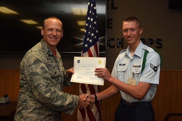 U.S. Air Force Lt. Col. Steven Watts, 17th Training Group Deputy Commander, presents the 315th Training Squadron Student of the Month award for April 2017 to Airman 1st Class Job Elliot, 316th TRS student, in Brandenburg Hall on Goodfellow Air Force Base, Texas, May 5, 2017. (U.S. Air Force photo by Airman 1st Class Caelynn Ferguson/Released)