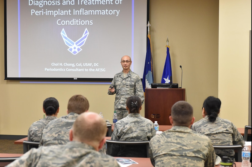Col. Chol Chong, 59th Dental Training Squadron Periodontics Residency Program director, speaks to an audience during a continuing education dental conference at Joint Base Charleston, S.C., May 5, 2017. Chong discussed the diagnosis and treatment procedures of peri-implant inflammatory conditions. The conference served as a forum to discuss growing trends and the way ahead for the Air Force dental community. Topics focused primarily on dental implants and procedures for treating potential complications that may arise after a procedure.