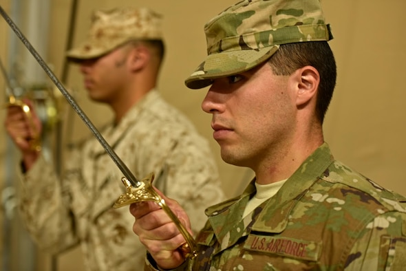 U.S. Air Force Senior Airman Jose Cobo Bernal, 407th Expeditionary Logistic Readiness Squadron materiel management technician, practices sword drill during a U.S. Marine Corps Corporal's Course May 2, 2017. The corporal's course is a 14-day formal training event designed to educate Marine corporals on the duties and responsibilities of an NCO. Deployed Airmen were granted the opportunity to attend the course, which is an eligibility requirement for Marines before promoting to the rank of sergeant. (U.S. Air Force photo by Senior Airman Ramon A. Adelan)