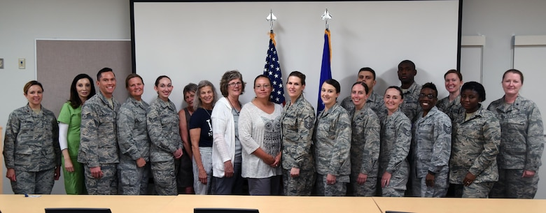 Some of the 377th Medical Group's nurses and technicians pose for a photo following a proclamation signing for National Nurses and Medical Technicians Week. The week honors nurses and technicians for their contributions to world-class healthcare.