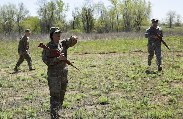 Staff Sgt. Makayla McConnell, 114th Security Forces Squadron security response team member, instructs her fellow Airmen on proper tactical squad movements May 6, 2017, on a training site near Sioux Falls S.D. McConnell is the first female from the 114th Security Forces Squadron to attend and complete Combat Leadership School. (U.S. Air National Guard photo by Staff Sgt. Duane Duimstra/Released)